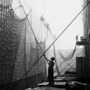 Man cleaning ship, dockworkers, NYC, 1947