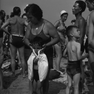 Woman drying off child, Coney Island, NYC, 1938