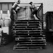 Men moving container, dockworkers, NYC, 1947